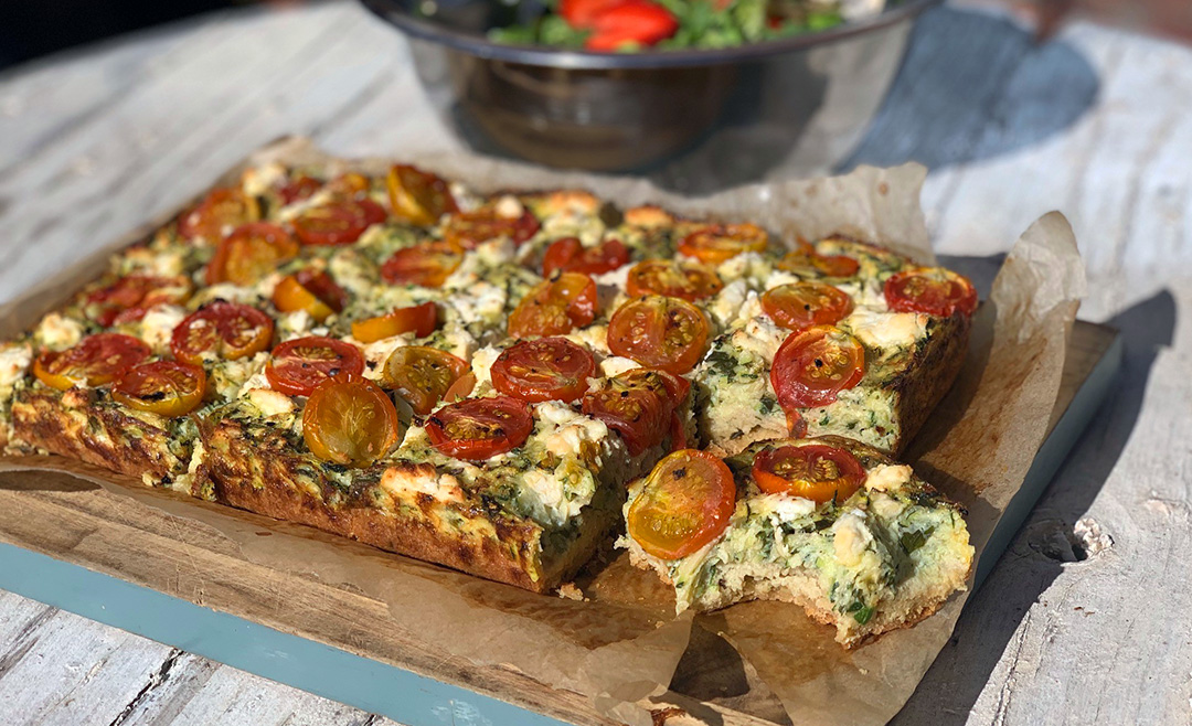 This Savory Zucchini Slice is a light yet filling warm vegetarian slice, using the last of summer's produce.